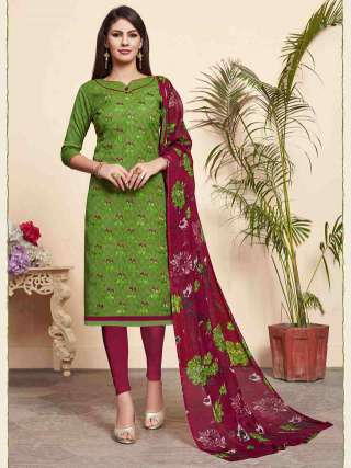 Green Colored Lakda Jacquard Fabric Top With Cotton Bottom Casual Wear Dress Material