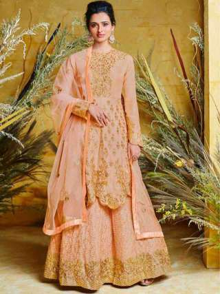 Outstanding Peach Colored Heavy Net With Pure Silk Partywear Embroidered Anarkali Suit
