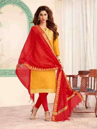 Yellow Banarasi Fabric Top With Cotton Bottom Casual Wear Dress Material